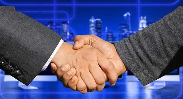 双方握手で提携のイメージ